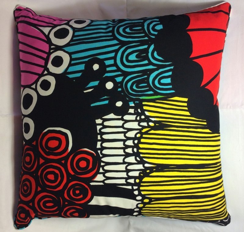 """Bold, colourful, 45 X 45 cm cushion in Marimekko's """"Siirtolapuutarha"""" fabric, $110 with feather insert, made by Chee Soon & Fitzgerald, 02 8399 1305, cheesoonfitzgerald.com. Popular in the '60s and '70s, Marimekko marries well with both contemporary and mid-century furniture."""