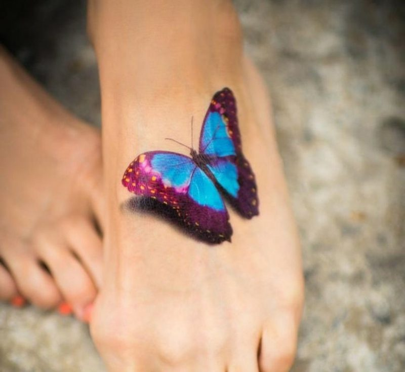 originelles Schmetterling Tattoo Fuss