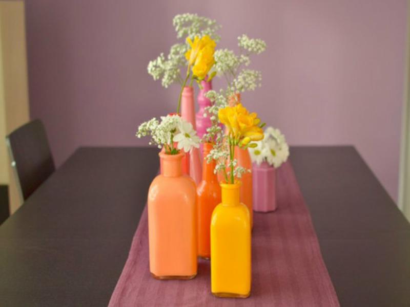 tischdekorationen in orange mit blumen