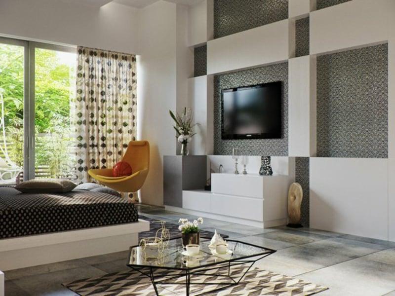 tv im schlafzimmer und gelbes sessel
