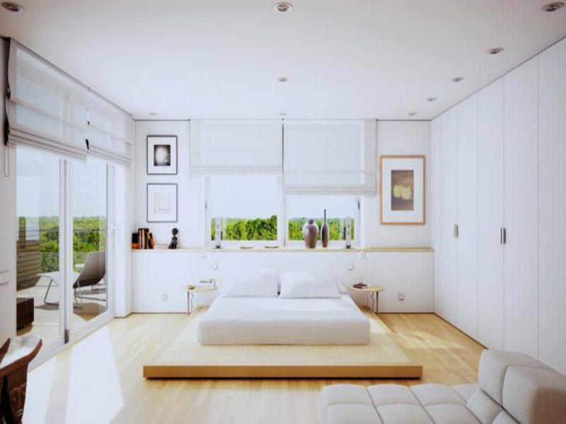 weiße schlafzimmergestaltung mit weißem bett