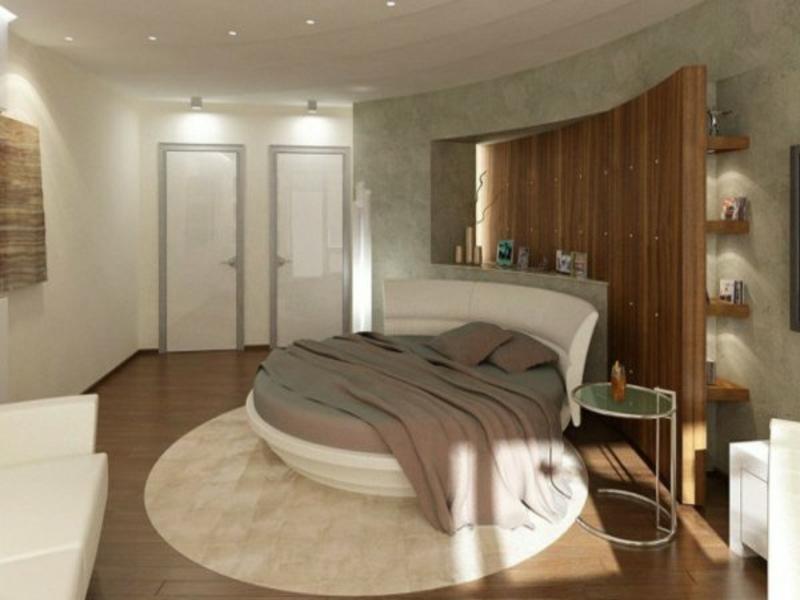 kleines schlafzimmer mit rundem teppich