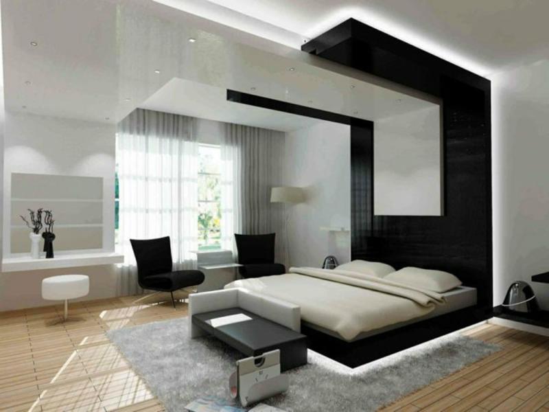 großes graues teppich unter dunklem bett