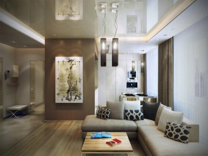 ecksofa und zwei lampen darüber im wohnzimmer