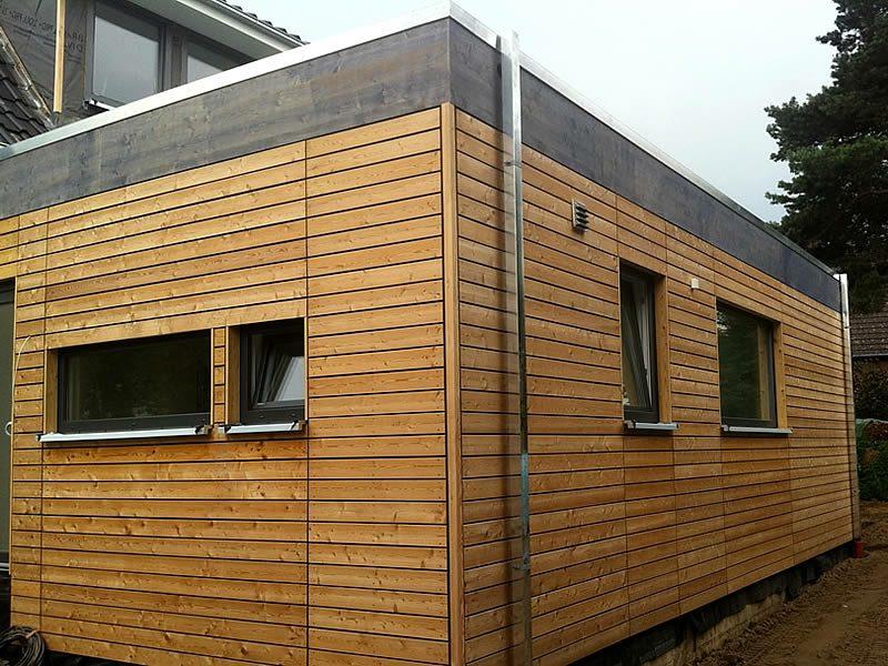 Hausfassaden kreative Gestaltungsideen Verkleidung aus Holz