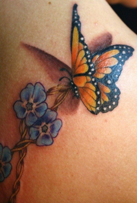 Schmetterling Tattoo Monarchfalter und Blume