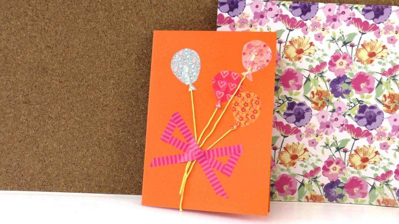 geburtstagskarten selbst gestalten in orangen farbe mit baloons