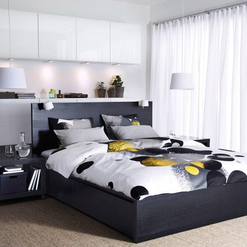 Ikea Besta Regal für ein Schlafzimmer in Schwarz-Weiß Design