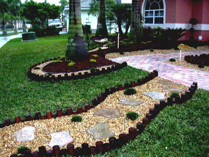 Steinbeet anlegen um einen Weg zu Haus zu bauen