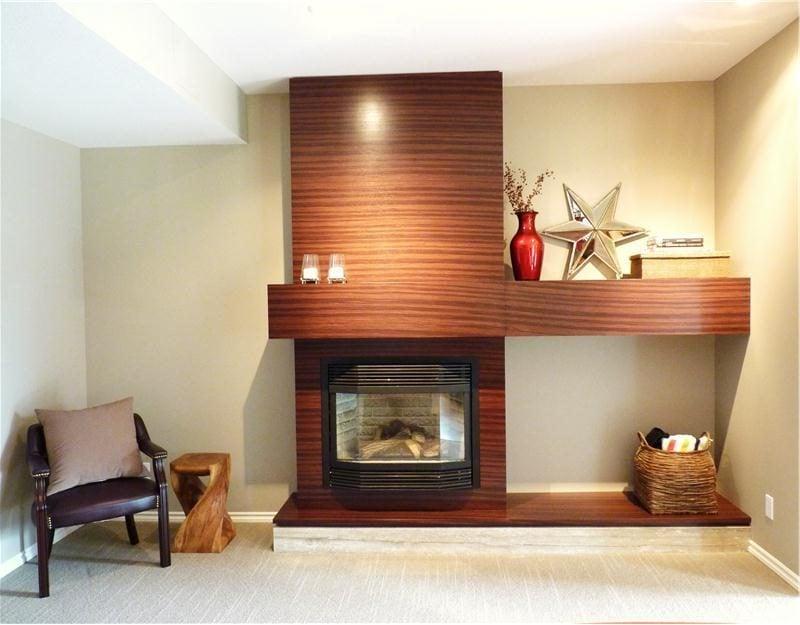 Kaminverkleidung aus Holz eignet sich perfekt sowohl für Landhausstil als auch für modernes Design