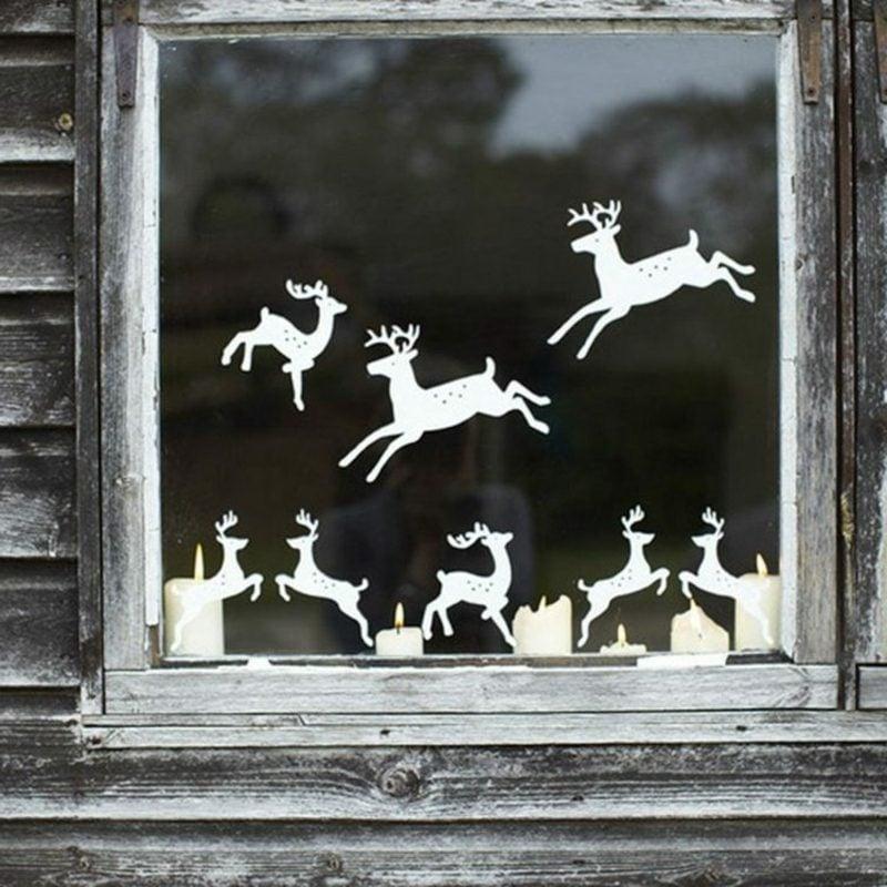 Fensterbilder zu Weihnachten Papierhirschen brennende Kerzen