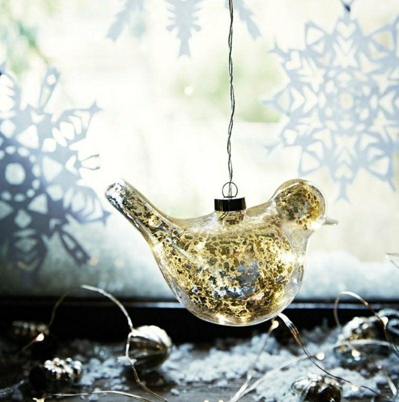 Fensterbilder zu Weihnachten Vogel Schneeflocken