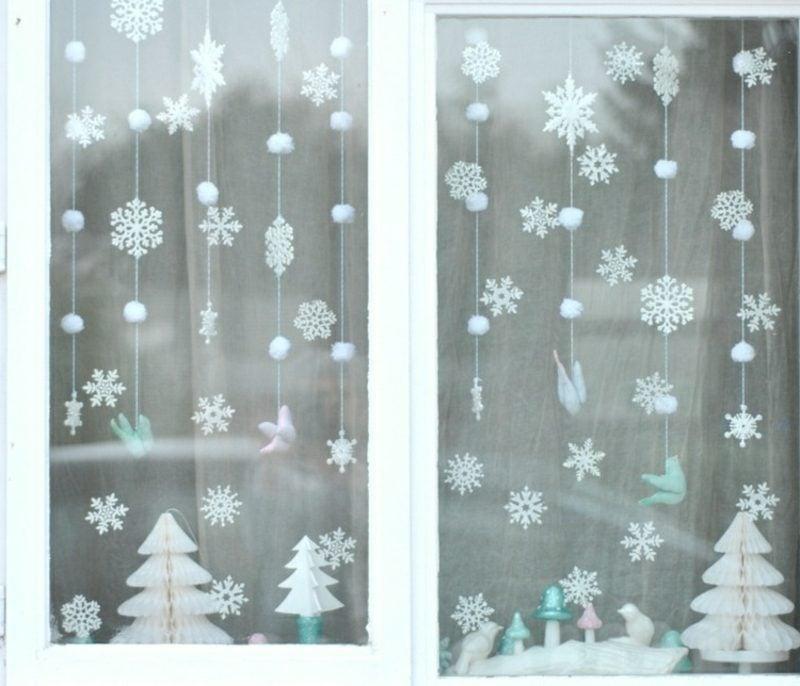 zauberhafte Fensterbilder zu Weihnachten Schneeflocken selber gebastelt