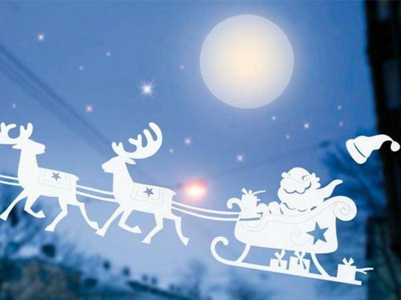 Fensterbilder zu Weihnachten Weihnachtsmann und seine Rentiere