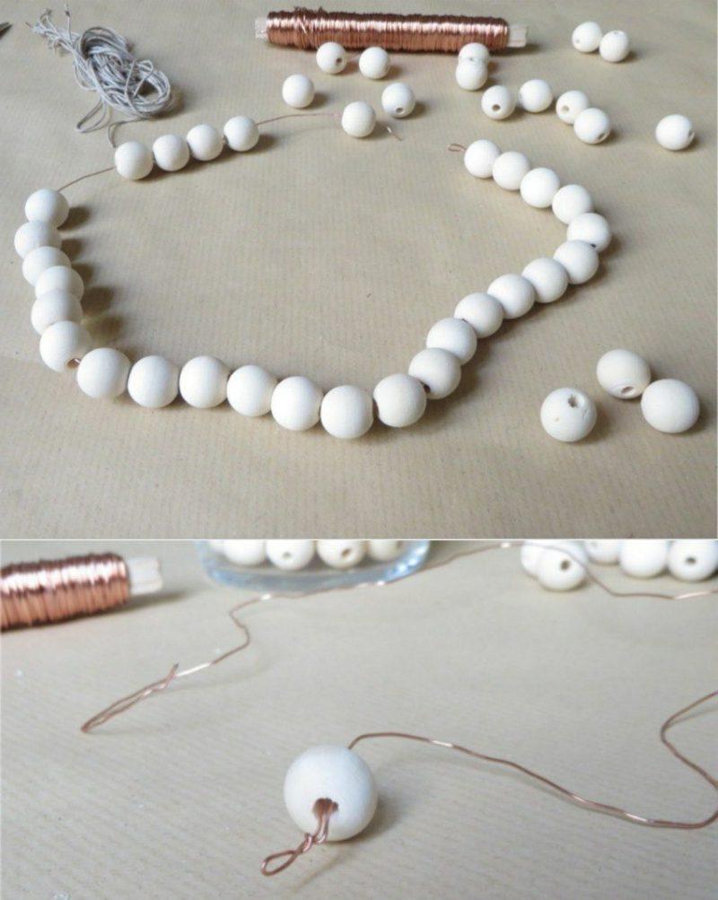 Basteln zu Weihnachten mit Kindern Stern aus Holzperlen die Perlen auffädeln