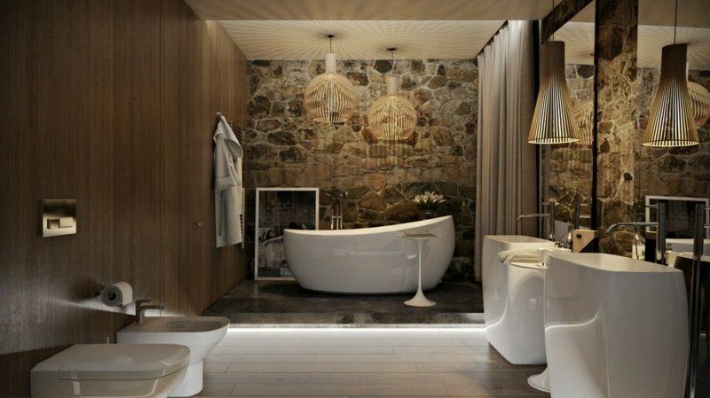 Luxus Badezimmer Akzentwand Natursteinverkleidung grosse Badewanne aus Porzellan indirekte Akzentbeleuchtung
