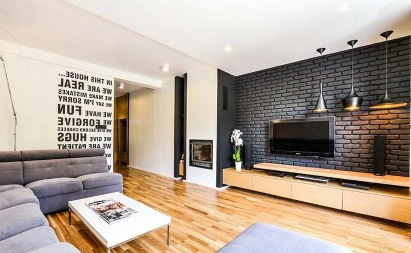 TV Wand im Wohnzimmer schwarze Backsteine Akzent im Interieur