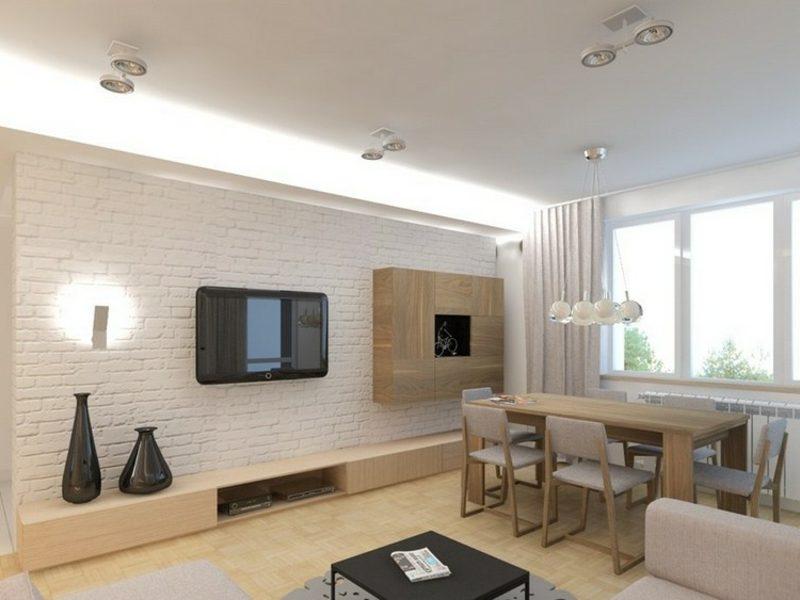 Fernseher, montiert an weisser Ziegelwand Esszimmer