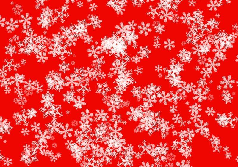 Geschenkpapier zu Weihnachten rot Schneeflocken