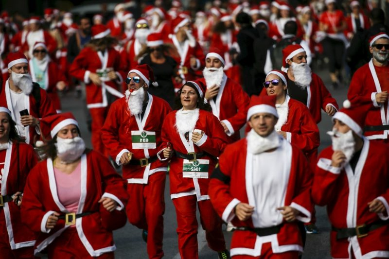 People dressed in Santa costumes take part in the Santa Claus Run