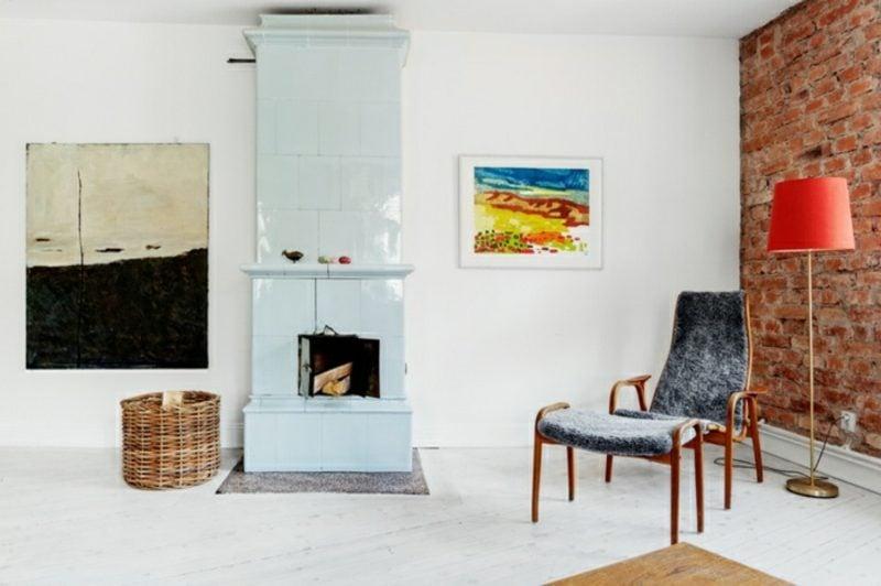 skandinavische Möbel origineller Armsesssel Kamin farbiges Bils als Akzent