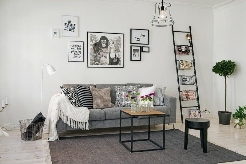 skandinavische Möbel Wohnzimmer origineller Teppich graues Polstersofa interessante Fotos und Bilder an der Wand