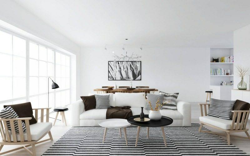 skandinavische Möbel Wohnzimmer origineller Teppich Streifen weiche Kissen neutrale Farbgestaltung