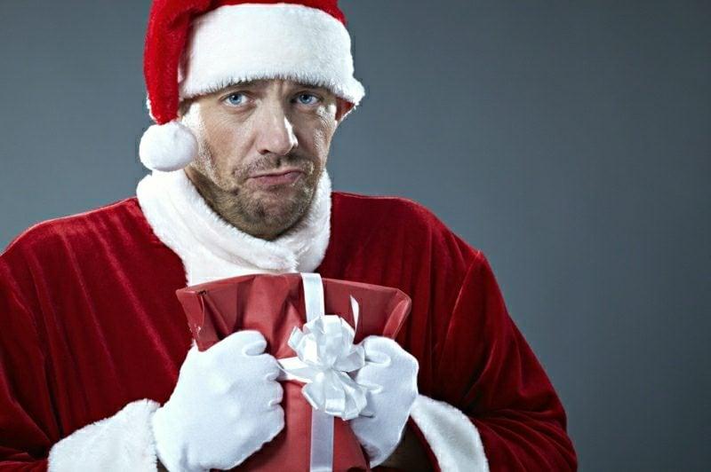 Santa Claus crumpling a gift box