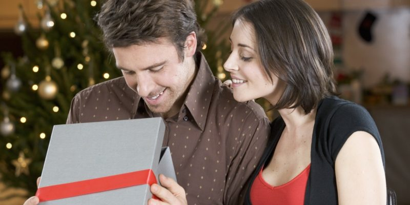 A husband and wife exchanging gifts