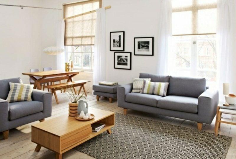 skandinavische Möbel Wohnzimmer graues Sofa Teppich mit geometrischen Motiven Couchtisch aus Massivholz