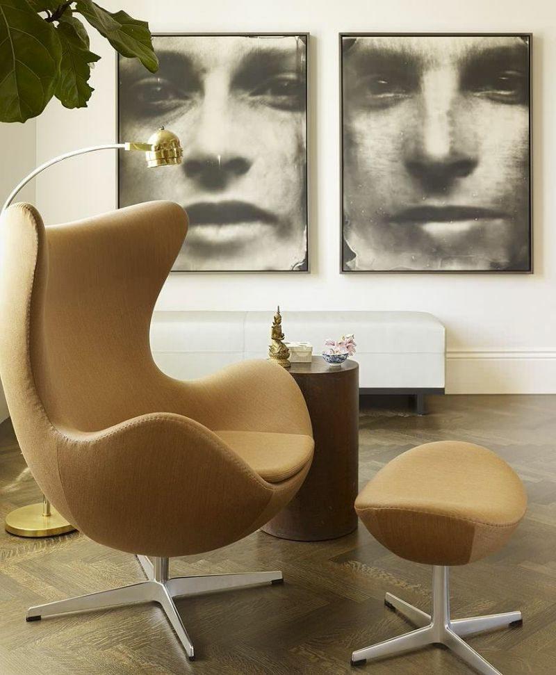 skandinavische Möbel bequemer Sessel in Beige extravagante Fotos an der Wand