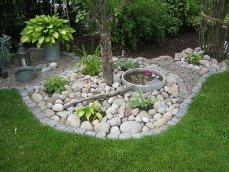 kreative Gartengestaltung Ideen Miniteich dekorativ Steine