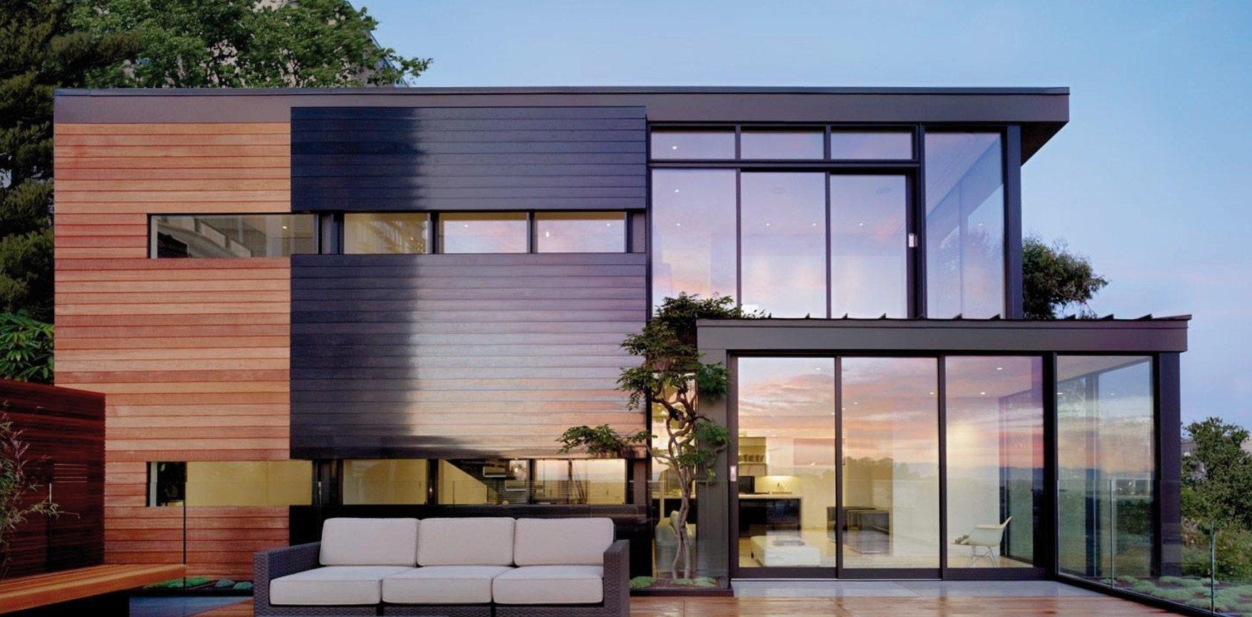 Resysta-Haus-Sofa-Baum-Holz-Fassade-Villa-Landhaus