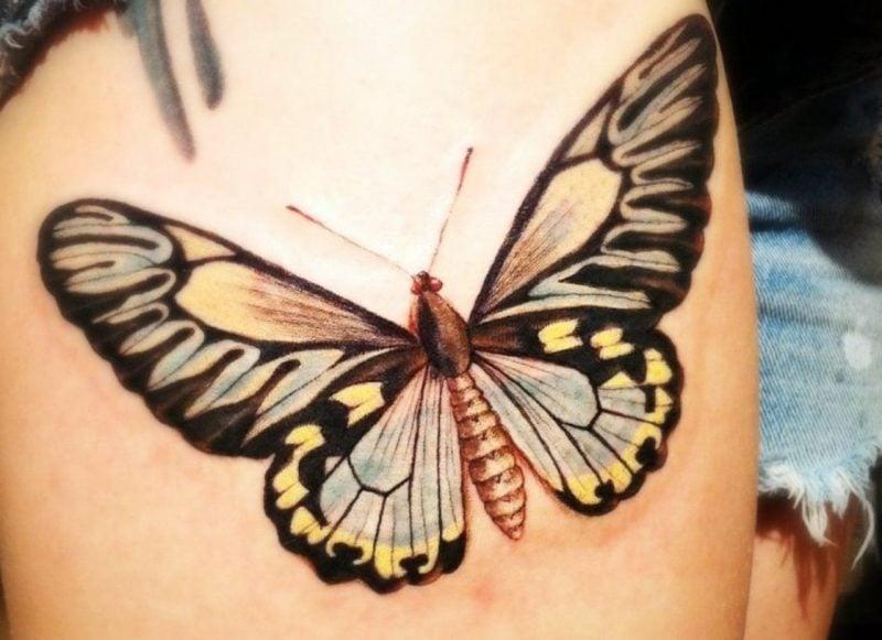 Tattoo Schmetterling gross farbig Oberarm