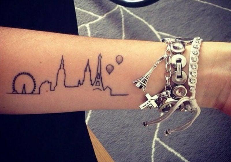 Tattoo auf Unterarm Silhouette Stadt Frau herrlicher Look