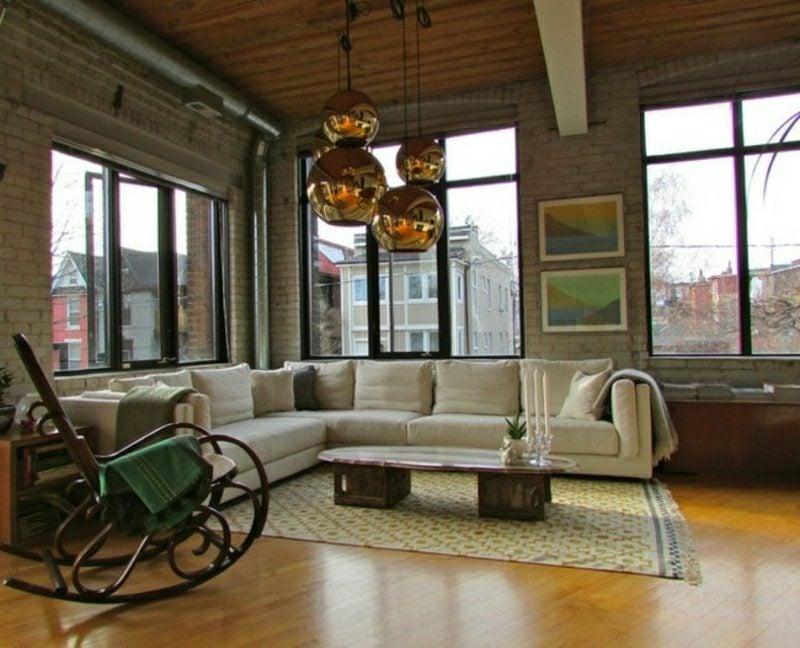 Wohnzimmer gestalten Chic im industriellen Stil Schaukelstuhl originelle Lampen