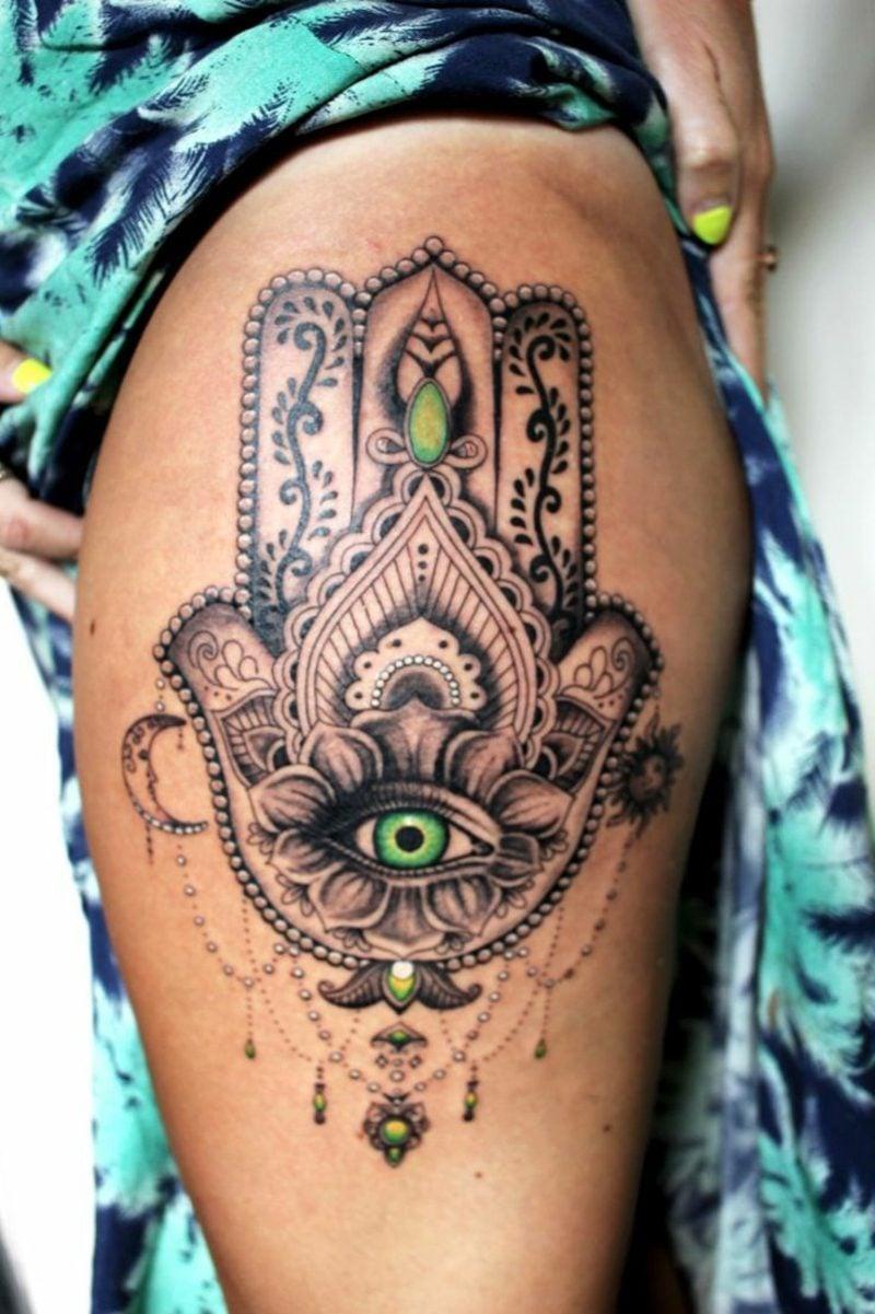 hamsa augen tattoo oberschenkel