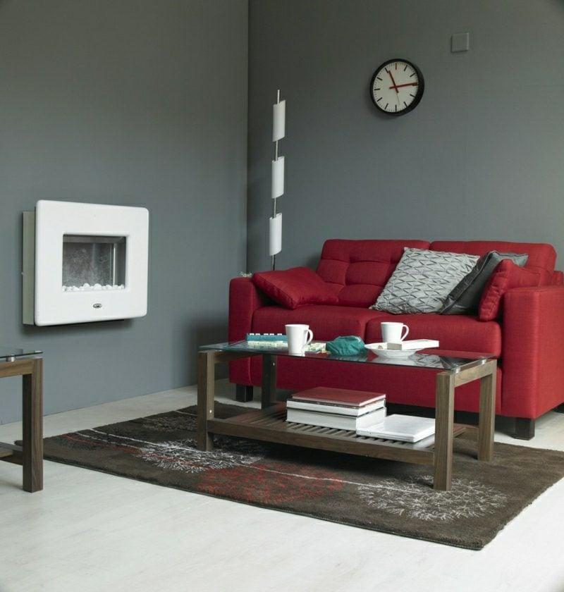 Wohnzimmer grau rote Couch als Akzent