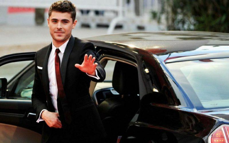Anzüge Herren schwarz weisses Hemd rote Krawatte