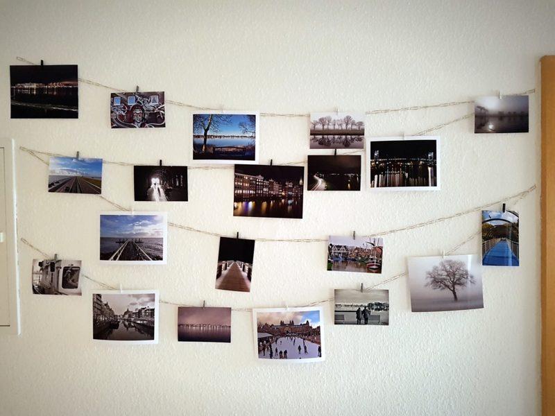 Fotowand gestalten ohne Bilderrahmen Wäscheklammern originell