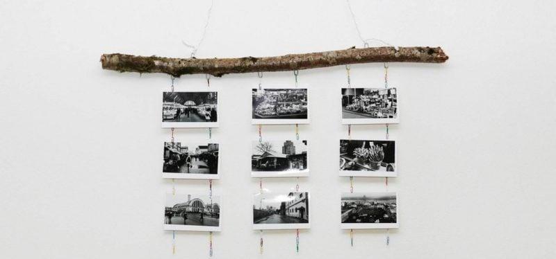 Fotowand gestalten ohne Bilderrahmen Naturmaterialien Ast