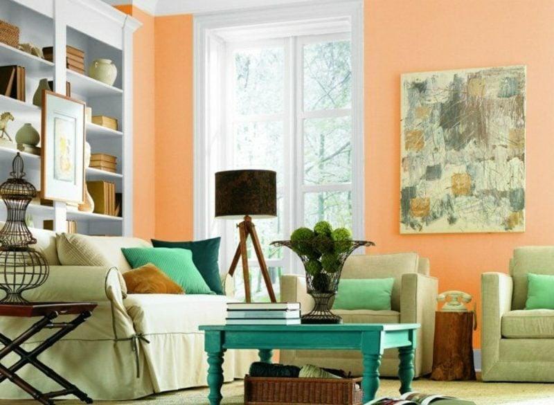 Wohnzimmer farblich gestalten hellorange Akzente Minzgrün