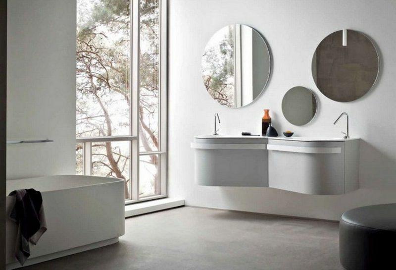 Waschbecken mit Unterschrank grau stilvoll runde Spiegel