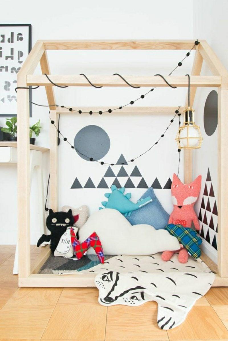 Kuschelecke Kinderzimmer originell dekorieren KissenGirlanden