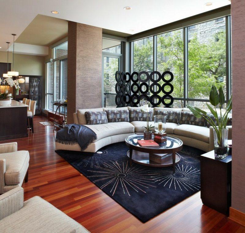 rundes Sofa weiss schwarzer Teppich Wohnzimmer