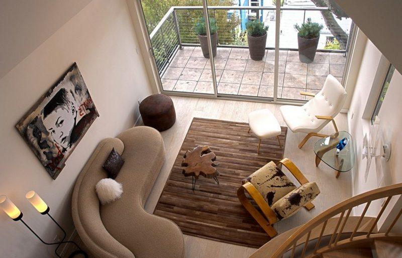rundes Sofa hellbraun Wohnzimmer Schaukelstuhl