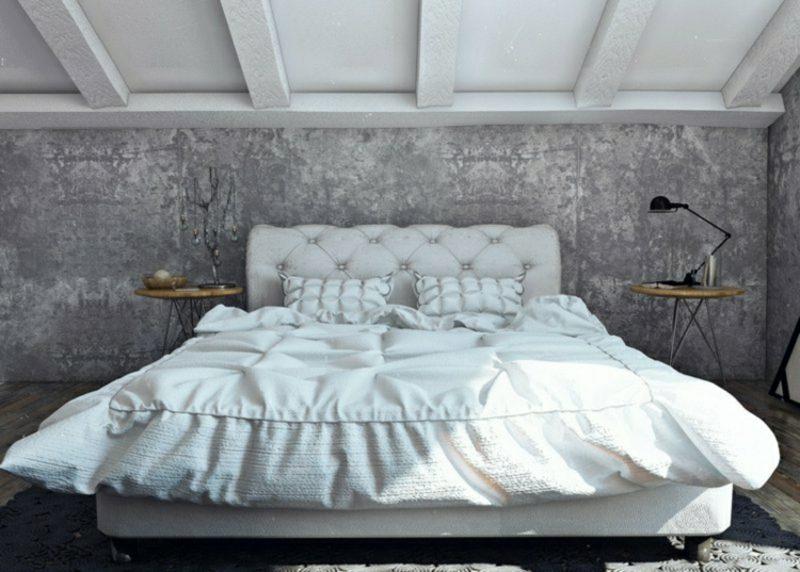Betonwand Schlafzimmer grosses Polsterbett