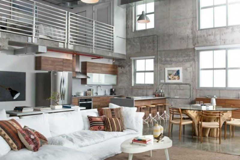 Betonwand modern grosser Wohnraum Wohnzimmer Küche