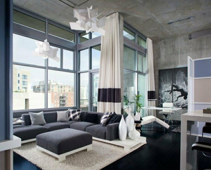 Betonwand Wohnzimmer Homeoffce minimalistisch Kronleuchter toll