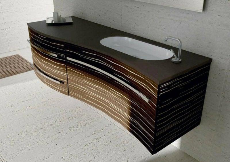 Waschbecken mit Unterschrank aus dunklem Holz schwebend